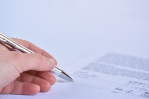 close-up-of-the-signing-of-a-contract_1161-97